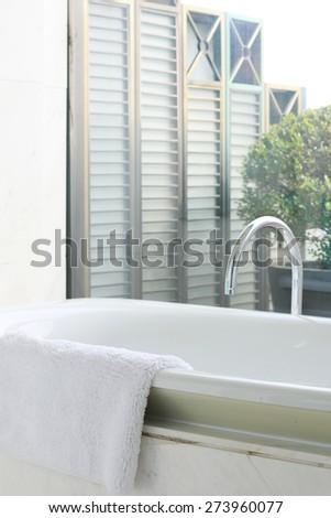 Hangzhou,China-April 22,2014:bath tub in bath room of Dragon hotel - stock photo