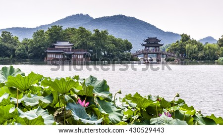 Hangzhou, China - August 14, 2011: Scenic view of Yudai Bridge On West Lake. West Lake has influenced poets and painters throughout Chinese history for its natural beauty and historic relics. - stock photo