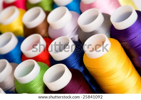 Hanks of multi-coloured threads for embroidery on a white background - stock photo