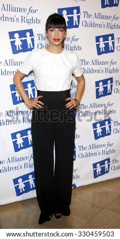 Hannah Simone at the Alliance for Children's Rights Dinner Honoring Kevin Reilly held at the Beverly Hilton Hotel in Beverly Hills, USA on March 1, 2012. - stock photo