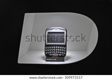 HANNOVER, GERMANY, 20 MARCH 2015 - BlackBerry Smartphone in typical rounded opening from BlackBerry logo. - stock photo
