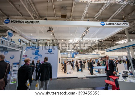 HANNOVER, GERMANY - MARCH 14, 2016: Booth of Konica Minolta company at CeBIT information technology trade show in Hannover, Germany on March 14, 2016. - stock photo