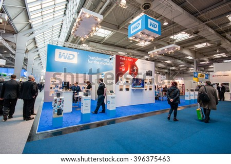 HANNOVER, GERMANY - MARCH 15, 2016: Booth of Western Digital company at CeBIT information technology trade show in Hannover, Germany on March 15, 2016. - stock photo