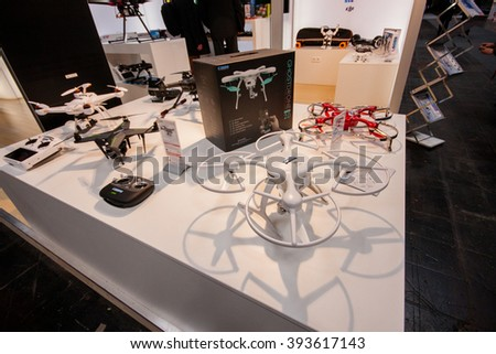 HANNOVER, GERMANY - MARCH 14, 2016: Multiple drones displayed at CeBIT information technology trade show in Hannover, Germany on March 14, 2016. - stock photo