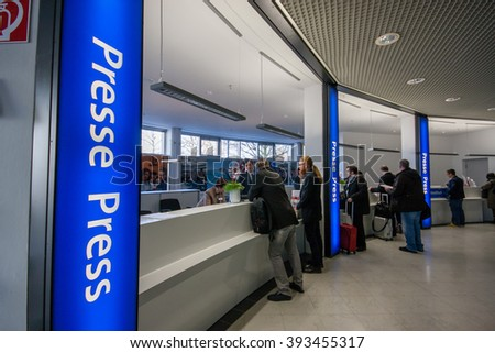 HANNOVER, GERMANY - MARCH 14, 2016: Press registration desk at CeBIT information technology trade show in Hannover, Germany on March 14, 2016. - stock photo