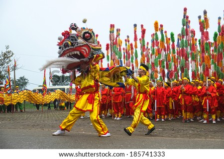 HANOI, VIETNAM - APRIL 06: A group of unidentified boys dance with their colorful lion during the traditional festival celebrations on April 06, 2014 in Ha Noi City, Vietnam. - stock photo