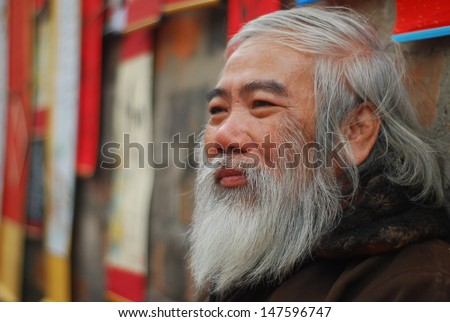 HANOI, VIETNAM, FEBRUARY 14: Old master is near ancient letter for everyone in lunar new year on February 14, 2013 in Hanoi, Vietnam. This is a tradition of vietnamese people in lunar new year  - stock photo