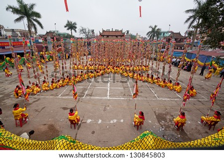 HANOI, VIETNAM - MARCH 29: A group of unidentified boys dance with their colorful dragons during the Tet Lunar New Year celebrations on March 29, 2012 in Ha Noi City, Vietnam. - stock photo