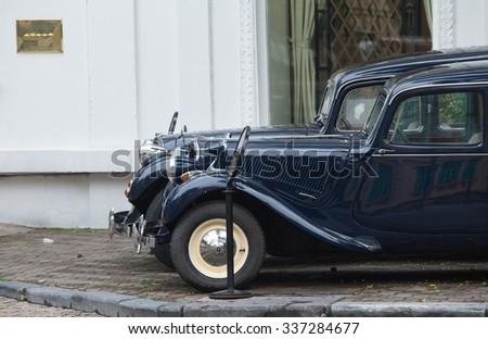 Hanoi, Vietnam - Nov 8, 2015: Two old Citroen cars parking in front of five stars Hotel Sofitel Legend Metropole Hanoi. These cars are for rent for tours around old street of Hanoi. - stock photo