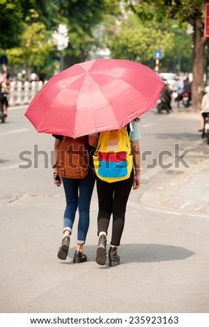 HANOI,VIETNAM - OCTOBER 12 : Vietnamese walking on the morning for exercise and relax common in the street in Old town on October 12,2014 in Hanoi city,Vietnam. - stock photo