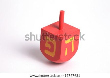 "Hanukkah Dreidel, isolated, the iasraeli version with the letter ""pe"" instead of ""shin"" - stock photo"