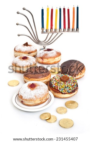 Hanukkah menorah with  candle and  doughnut  - stock photo