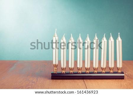 Hanukkah menorah with silver candles - stock photo