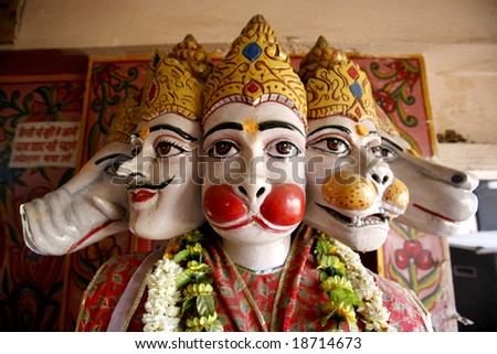 Hanuman incarnations heads in hanuman temple in delhi - stock photo