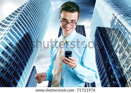 Hapiness Businessman standing on the business background - stock photo
