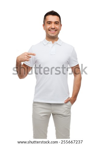 happiness, advertisement, fashion, gesture and people concept - smiling man in t-shirt pointing finger on himself - stock photo