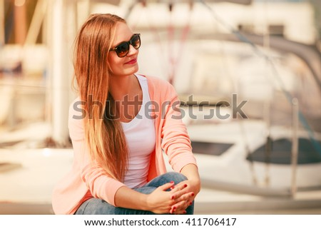 Happiness and joy. Portrait of beauty fashionable woman in sunglasses outdoor in marina. Summertime. - stock photo