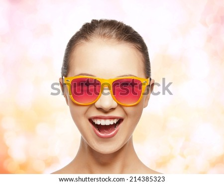 happiness and people concept - portrait of happy teenage girl in pink sunglasses - stock photo