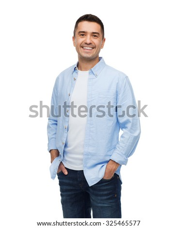happiness and people concept - smiling man with hands in pockets - stock photo