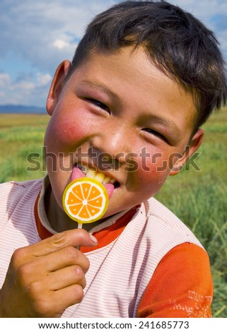 Happiness Asian boy with his candy. - stock photo