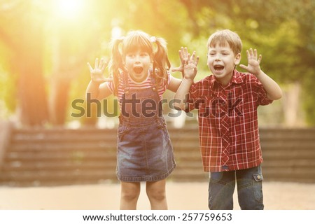 Happiness boy and girl fun outdoor under sunlight - stock photo