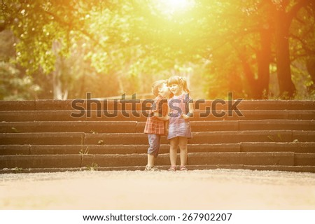 Happiness boy and girl with flower fun outdoor under sunlight - stock photo
