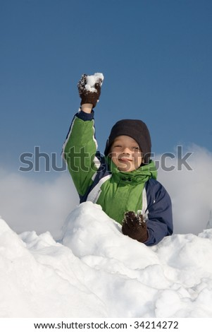 Happiness boy playing snowballs - stock photo