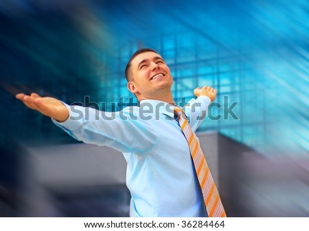 Happiness business man on blur business architecture background - stock photo