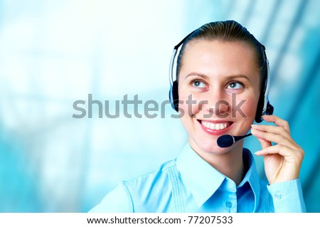 Happiness businesswoman speak in headphones on blur business architecture background - stock photo