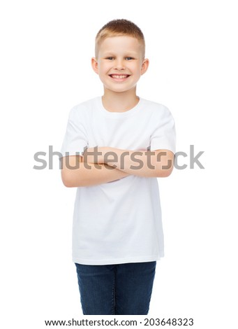 happiness, childhood and people concept - smiling little boy in white t-shirt with his arms crossed - stock photo