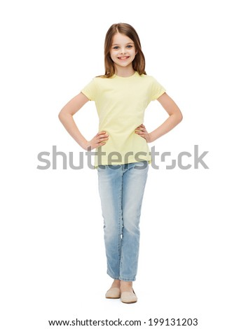 happiness, childhood and people concept - smiling little girl in casual clothes - stock photo