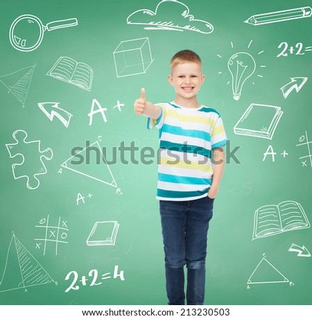 happiness, childhood, school, education and people concept - smiling little boy showing thumbs up over green board with doodles background - stock photo