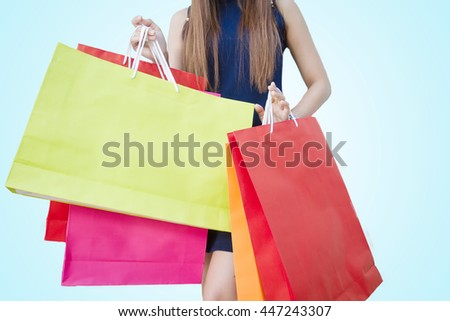 happiness, consumerism, sale and people concept - smiling young woman asian with shopping bags - stock photo