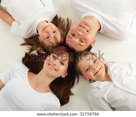 Happiness family on the white background. Many happy families search in my portfolio - stock photo