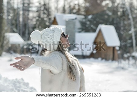 Happiness female near the winter villa in leisure time. - stock photo