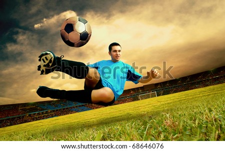 Happiness football player on field of olimpic stadium on sunrise sky - stock photo