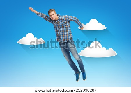happiness, freedom, movement and people concept - smiling young man flying in air over blue sky with white clouds background - stock photo