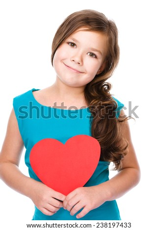 Happiness, health and love concept - smiling girl with red heart, isolated over white - stock photo