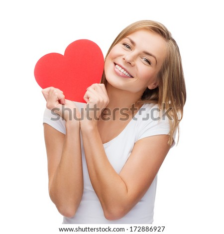 happiness, health and love concept - smiling woman in white t-shirt with heart - stock photo