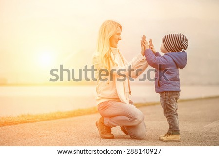 Happiness Mother and son outdoor - stock photo