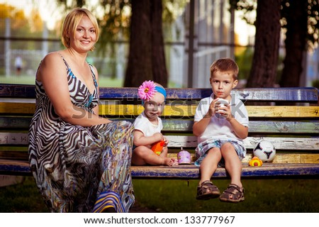 Happiness - mother with her child outside on a summer day. Happy family. Mother and daughter enjoy the early spring in the park. happy young mother playing with her son in the park - stock photo
