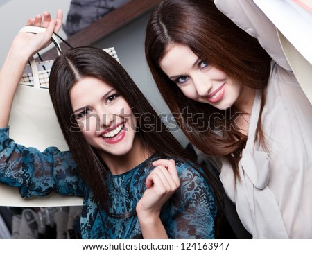 Happiness of two girlfriends after purchasing - stock photo