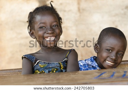 Happiness Symbol: Couple of African Children Laughing at School  - stock photo