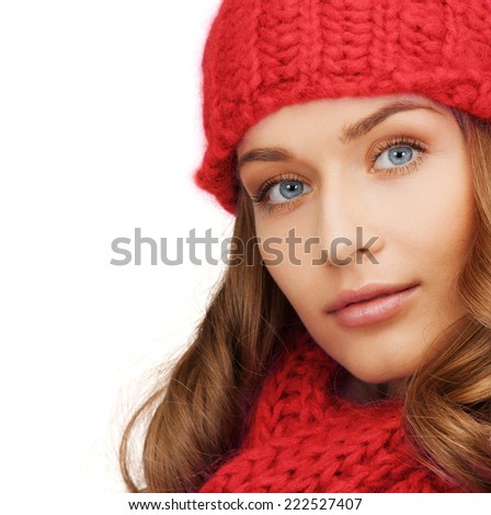 happiness, winter holidays, christmas and people concept - close up of smiling young woman in red hat and scarf over white background - stock photo