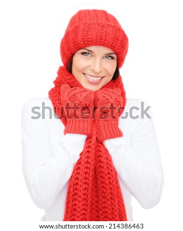 happiness, winter holidays, christmas and people concept - smiling young woman in red hat, scarf and mittens over white background - stock photo