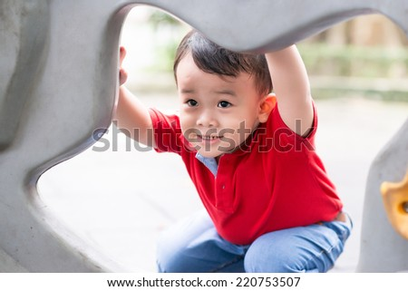 Happiness without limit, happy asian child outdoor, face focus - stock photo