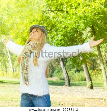 Happiness woman with raised hands enjoying in the nature. - stock photo