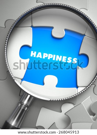 Happiness - Word on the Place of Missing Puzzle Piece through Magnifier. Selective Focus. - stock photo