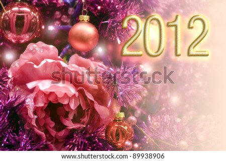 Happy 2012 a festive decoration for a happy new year in red with flower - stock photo