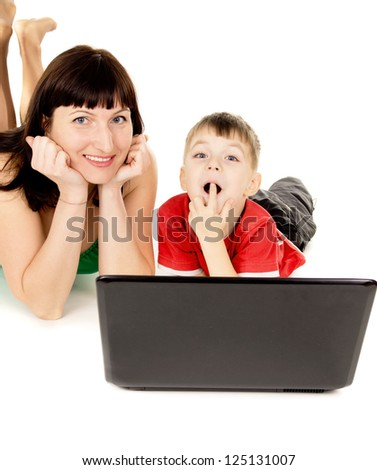 happy a small child with her mother watch the movie the notebook isolated on white background - stock photo